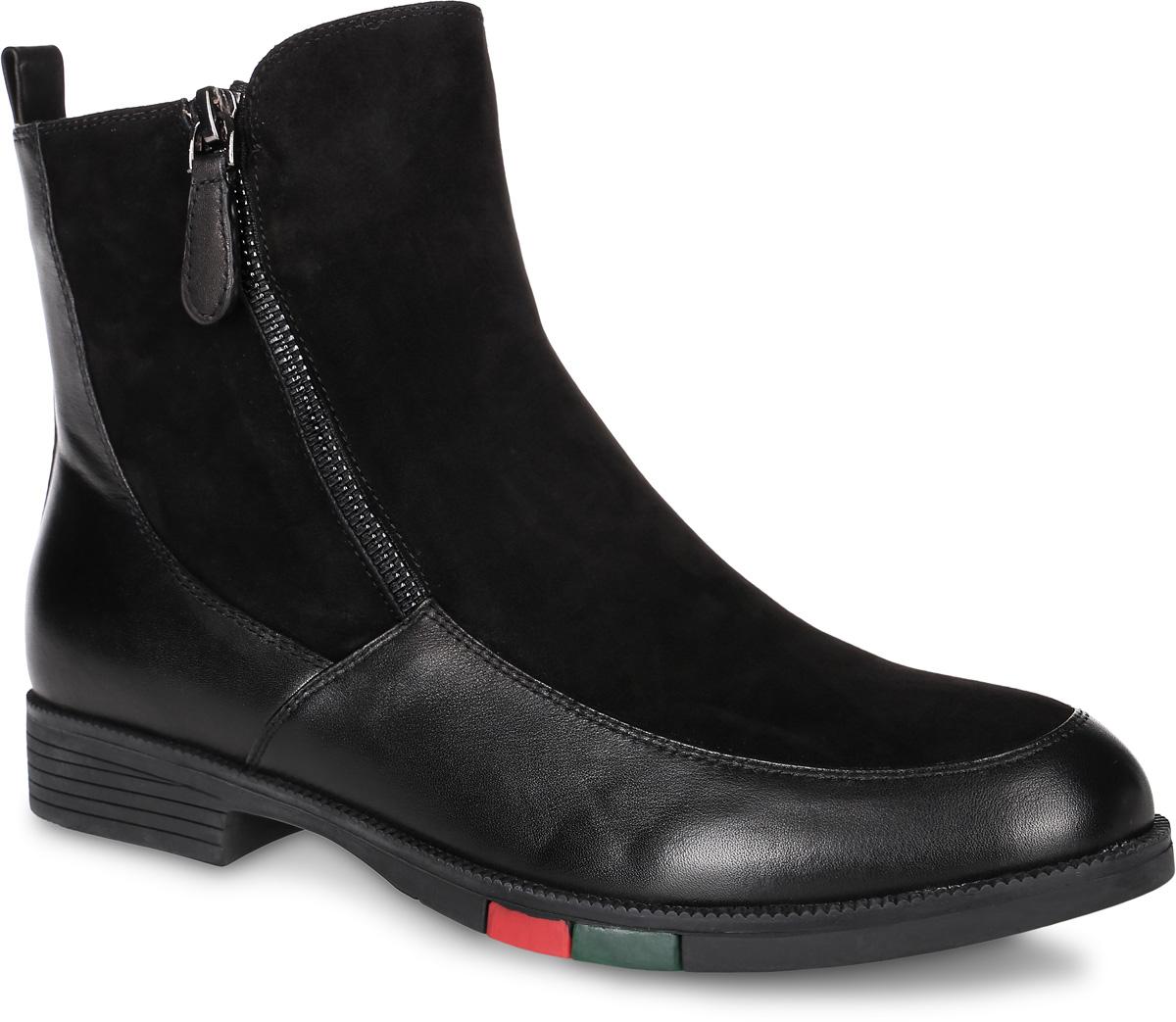 W2114-T03-1Женские ботинки выполнены из натуральной кожи и замши. Стелька и внутренняя поверхность выполнены из натуральной кожи, которая обеспечит комфорт при движении и предотвратит натирание. Ботинки дополнены двумя молниями по бокам. Подошва, выполненная из термопластичного материала, оснащена рифлением.
