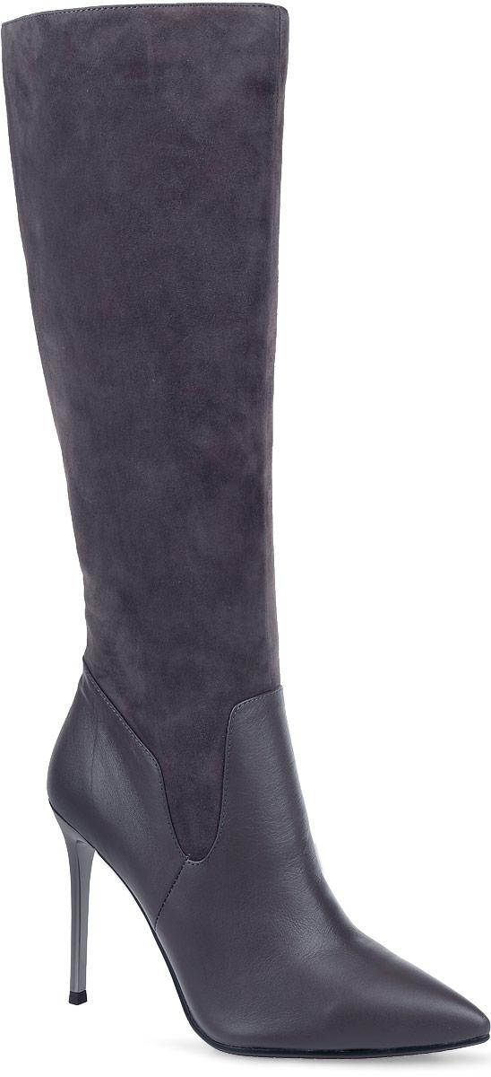 91-125-41-5Стильные женские сапоги от Paolo Conte выполнены из натуральной кожи и натурального велюра. Подкладка и стелька выполнены из байки. Застегивается модель на боковую застежку-молнию. Эластичные вставки на голенище обеспечивают идеальную посадку модели на ноге. Ультравысокий каблук-шпилька, стилизованный под металл, невероятно устойчив. Подошва и каблук дополнены рифлением.