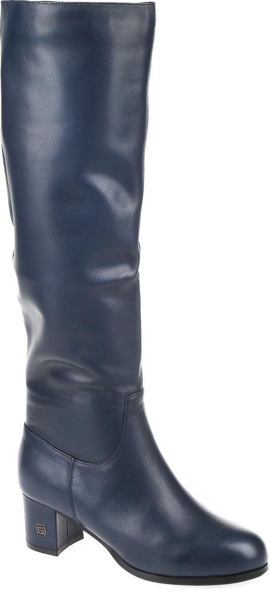 W2172-X01-4BMМодные женские сапоги от Graciana выполнены из натуральной кожи. Подкладка из байки и натурального меха, и стелька из натурального меха не дадут ногам замерзнуть. Застегивается модель на боковую застежку-молнию. Каблук средней высоты невероятно устойчив. Подошва и каблук дополнены рифлением.
