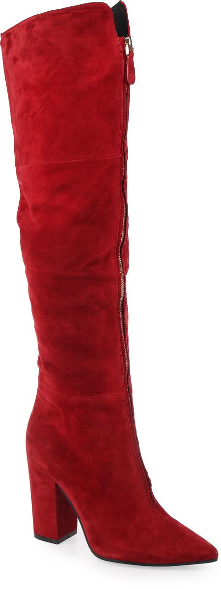 2043-T15-5Женские ботфорты с вытянутым носком от Graciana выполнены из натуральной замши. Спереди модель украшена декоративной молнией. Изделие оформлено застежкой-молнией до середины голенища и дополнено вставкой из эластичной резинки. Подкладка и стелька изготовлены из байки, подошва с устойчивым каблуком - из полимерного термопластичного материала.