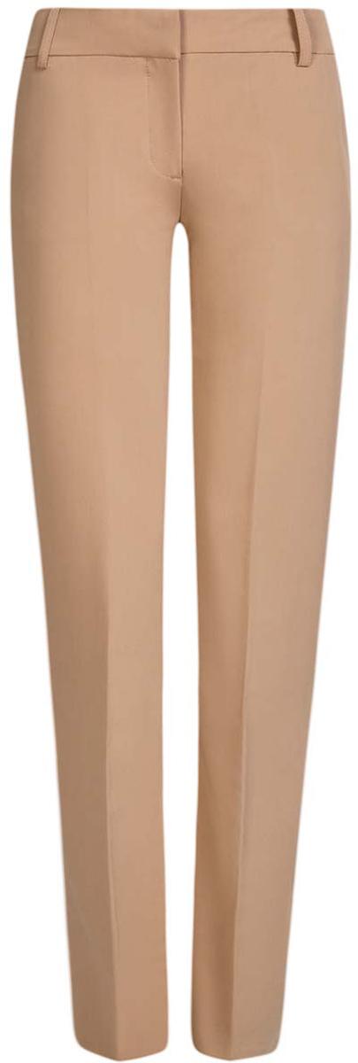 Брюки21703075-5B/18600/2900NСтильные женские брюки oodji Collection выполнены из полиэстера с добавлением вискозы и эластана. Модель с стандартной посадкой оформлена сзади декоративным карманом. По бокам изделие дополнено втачными карманами. Застегиваются брюки на молнию, пуговицу и застежку-крючок. Также модель оснащена шлевками для ремня.