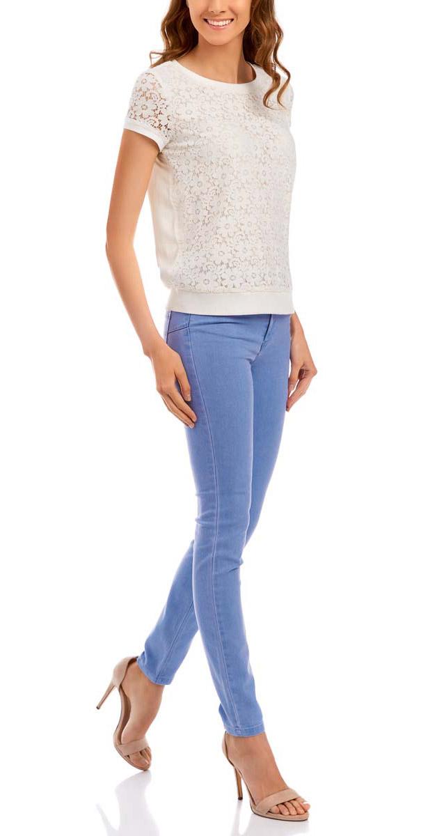 Джинсы12104059/45596/7000WЖенские джинсы oodji Ultra с длиной штанин 7/8 изготовлены из хлопка с добавлением полиэстера и полиуретана. Изделие имеет два накладных кармана сзади и три классических кармана спереди. Джинсы обладают эффектом пуш-апа.
