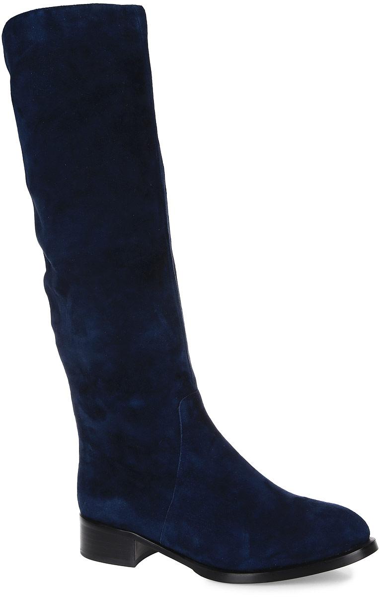T207-T50-7BMЖенские сапоги от Graciana выполнены из натуральной замши. Подкладка изготовлена из натурального меха и байки, стелька - из натурального меха. Подошва из полимерного термопластичного материала дополнена небольшим каблуком.