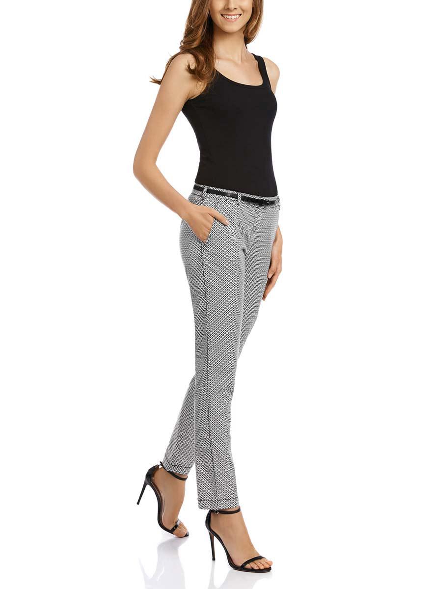 11706190-4M/43284/1229GСтильные женские брюки oodji Ultra выполнены из хлопка с добавлением эластана. Модель со стандартной посадкой оформлена сзади декоративными карманами. Спереди брюки имеют два втачных кармана и застегиваются на застежку-молнию и пуговицу. Также модель оснащена шлевками и тонким ремнем.