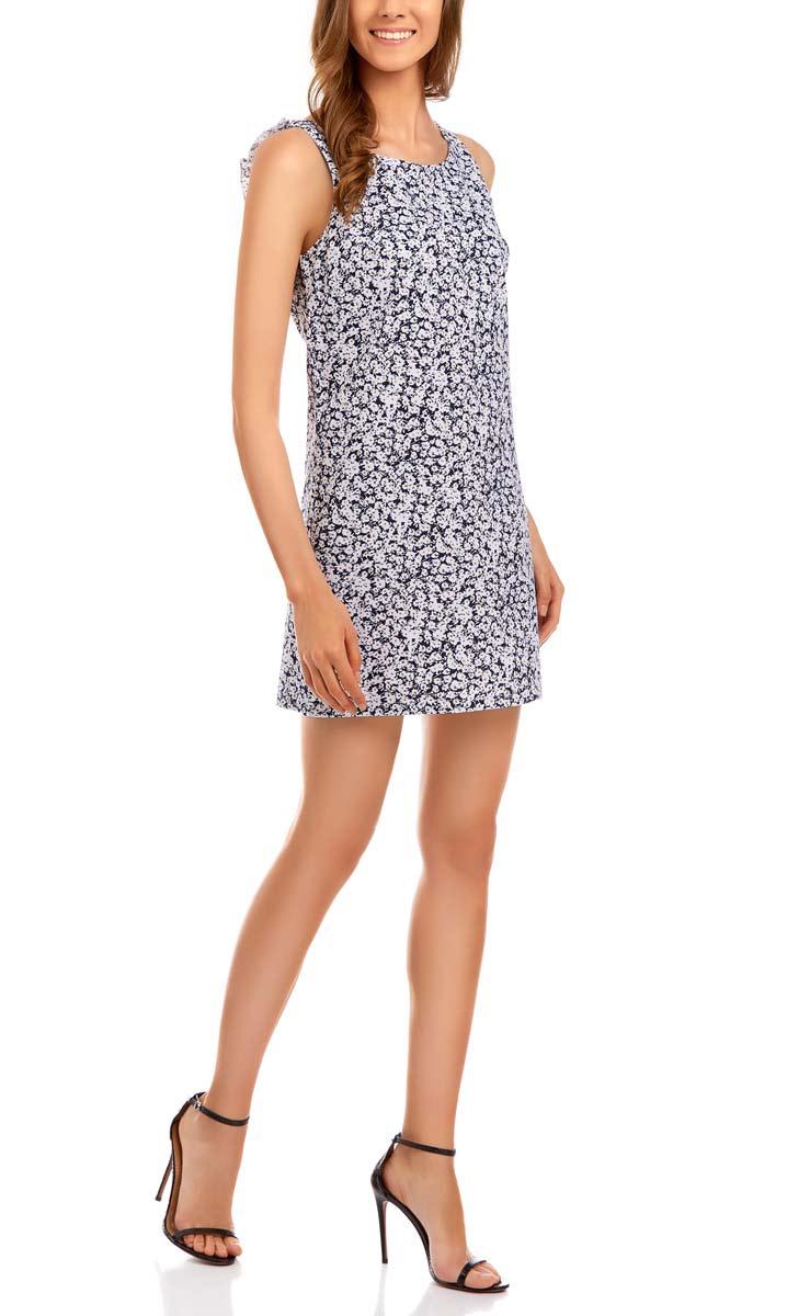 Платье11901149/17298/2910FМодное платье oodji Ultra станет отличным дополнением к вашему гардеробу. Модель выполнена из натурального хлопка. Платье-мини без рукавов с круглым вырезом горловины застегивается сзади по спинке на потайную застежку-молнию. V-образный вырез на спинке дополнен стильной трикотажной рюшей. Модель оформлена интересным цветочным принтом.