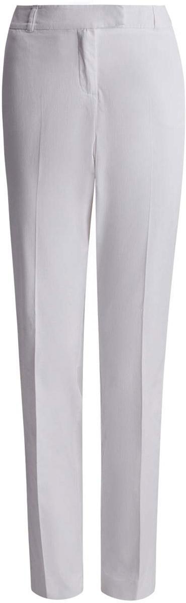 21704159-1/14522/1000NСтильные женские брюки oodji Collection выполнены из хлопка с добавлением эластана. Модель со стандартной посадкой оформлена сзади декоративными карманами. По бокам изделие дополнено втачными карманами. Застегиваются брюки на молнию, пуговицу и застежку-крючок. Также модель оснащена шлевками для ремня.