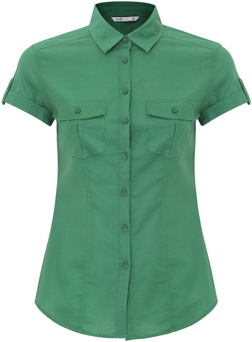 11402084/26491/6E00NЖенская рубашка oodji Ultra выполнена из натурального хлопка. Модель с отложным воротником и короткими рукавами на груди дополнена двумя накладными карманами с клапанами на пуговицах.