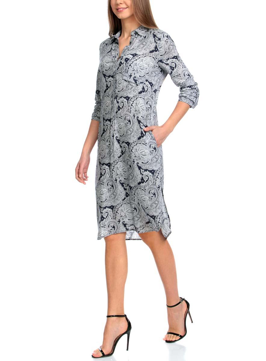 Платье21900318-2/42127/7912EМодное платье oodji Collection станет отличным дополнением к вашему гардеробу. Модель выполнена из качественной вискозы. Платье-миди с отложным воротником и длинными рукавами застегивается спереди на шесть пуговиц. Манжеты на рукавах также имеют застежки-пуговицы. Оформлено изделие на груди накладным карманом и по бокам дополнено небольшими разрезами. Выполнено платье принтом с узорами.