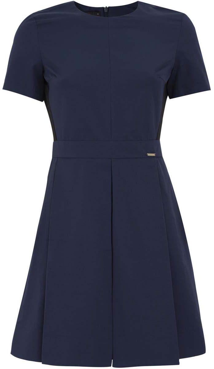 Платье11910084M/42167/7929BСтильное приталенное платье oodji Ultra - модное решение на каждый день. Модель мини-длины с пышной юбкой, выгодно подчеркивающая достоинства фигуры, выполнена из плотного хлопкового материала. Изделие имеет вшитый пояс и застегивается на скрытую застежку-молнию на спинке.