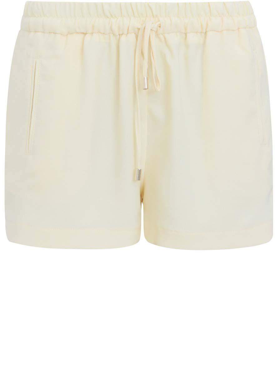Шорты21800018/42818/5000NСтильные женские шорты oodji Collection изготовлены из 100% полиэстера. Пояс оснащен вставкой из эластичной резинки и шнурками. Лицевая сторона дополнена имитацией карманов.