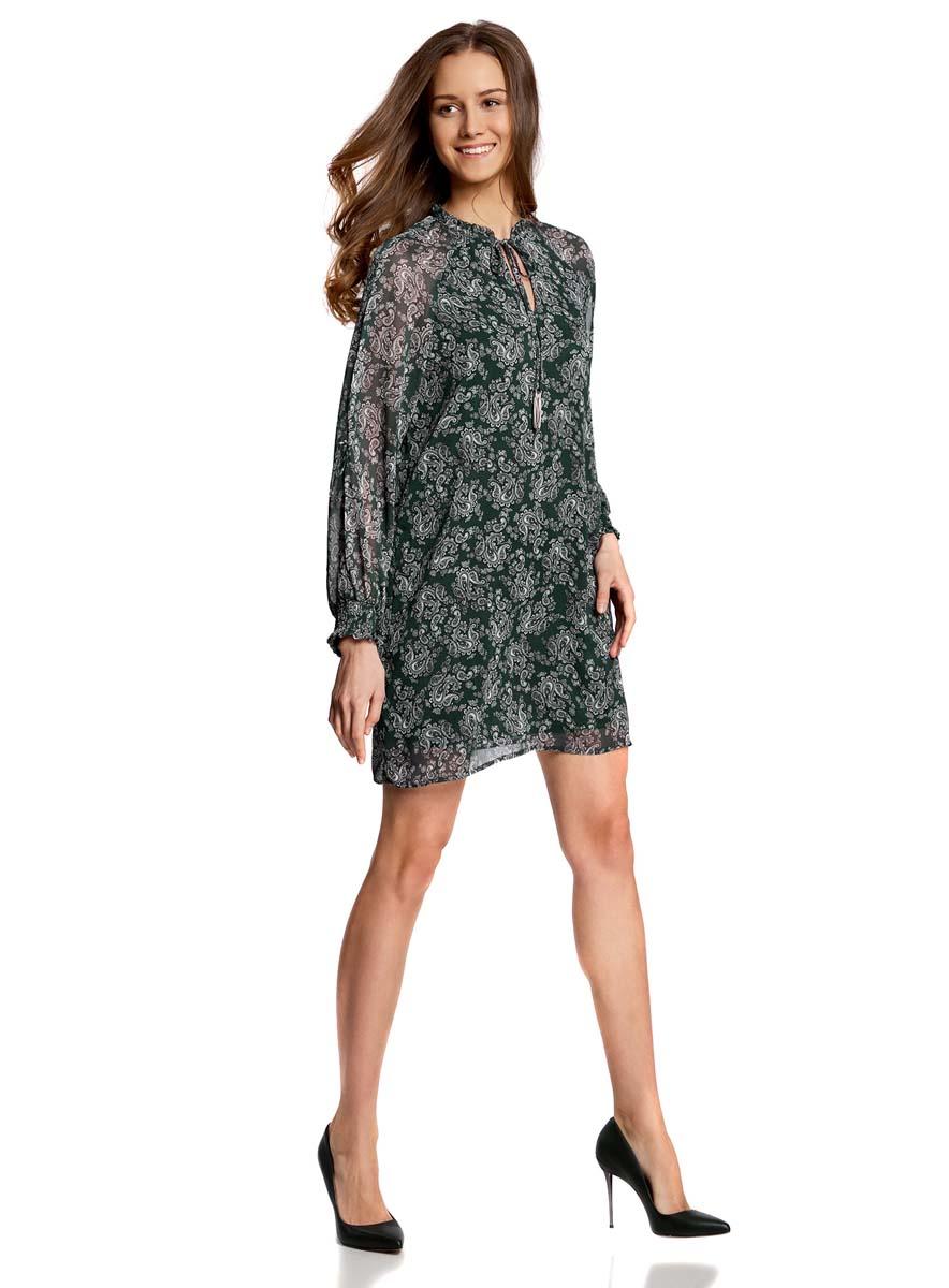 Платье11914001/15036/6912EСтильное платье oodji Ultra выполнено из качественного полиэстера. Подкладка изделия также изготовлена из полиэстера. Модное шифоновое платье-мини с круглым вырезом горловины и длинными рукавами-реглан дополнена спереди завязками. Завязки имеют на кончиках оригинальные металлические кисточки. Рукава модели дополнены манжетами на широких резинках и оригинальными прорезями вдоль рукава с завязками-бантиками. Вырез горловины оформлен нежной рюшей.