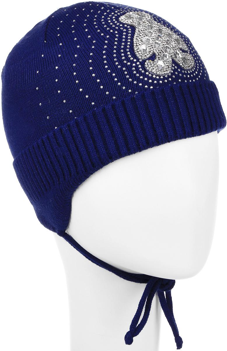 Шапка детскаяK034-22Стильная шапка для девочки InFante идеально подойдет для прогулок в прохладное время года. Изготовленная из хлопка, она обладает хорошими дышащими свойствами и хорошо удерживает тепло. Шапка декорирована аппликацией из страз. Модель дополнена отворотом. На ушках имеются завязки, с помощью которых шапку можно зафиксировать под подбородком. Такая шапка станет модным и стильным предметом детского гардероба. Уважаемые клиенты! Размер, доступный для заказа, является обхватом головы ребенка.
