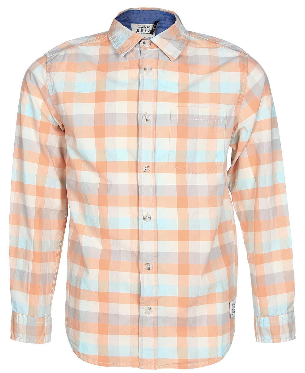 РубашкаH-812/179-7121Рубашка для мальчика Sela выполнена из натурального хлопка. Рубашка с длинными рукавами и отложным воротником застегивается на пуговицы спереди. Манжеты рукавов также застегиваются на пуговицы. Рубашка оформлена принтом в клетку. На груди расположен накладной карман.