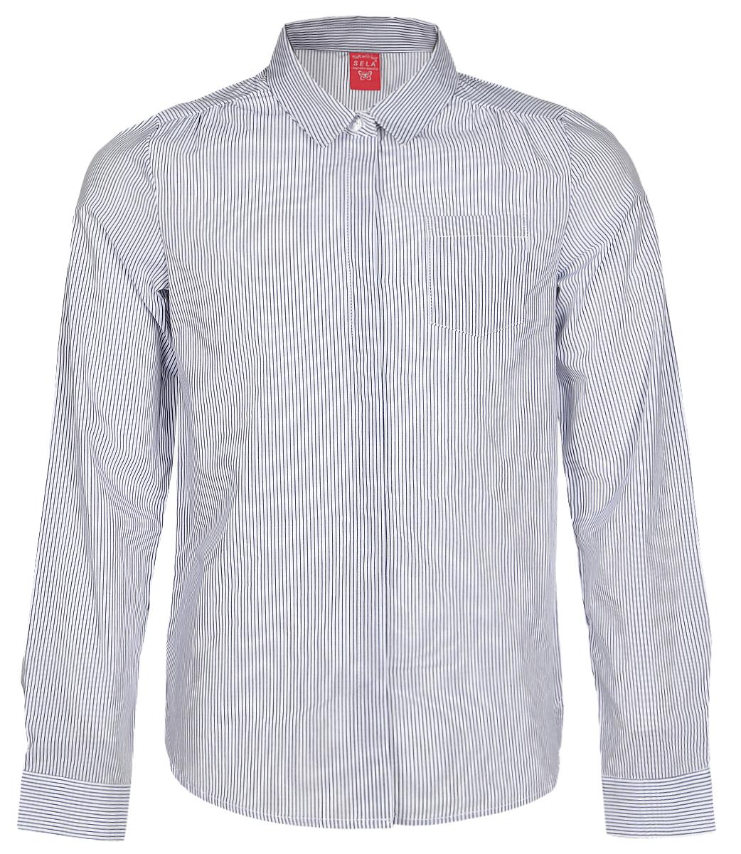 РубашкаB-612/845-7151Рубашка для девочки Sela выполнена из натурального хлопка. Рубашка с длинными рукавами и отложным воротником застегивается на пуговицы спереди. Манжеты рукавов также застегиваются на пуговицы. Рубашка оформлена принтом в полоску. На груди расположен накладной карман.