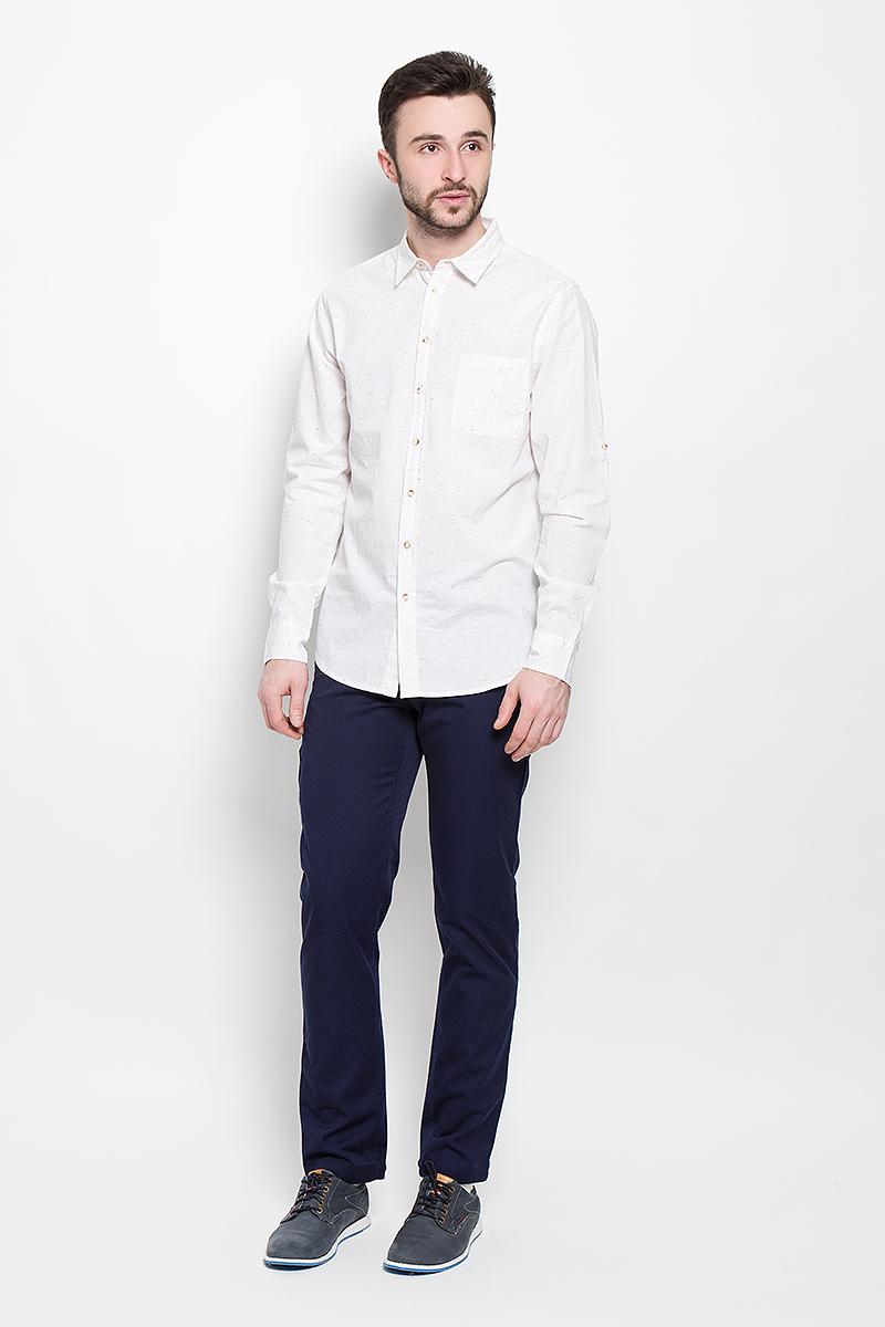 РубашкаH-212/743-7111Мужская рубашка Sela Casual Wear выполнена из натурального хлопка. Рубашка с длинными рукавами и отложным воротником застегивается на пуговицы спереди. Манжеты рукавов также застегиваются на пуговицы. Рукава дополнены хлястиками на пуговицах, позволяющими зафиксировать их в закатанном состоянии. На груди расположен накладной карман.