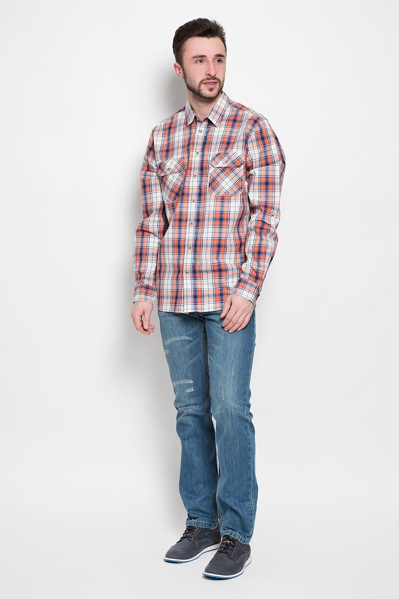 H-212/760-7120Мужская рубашка Sela Casual Wear выполнена из натурального хлопка. Рубашка с длинными рукавами и отложным воротником застегивается на пуговицы спереди. Манжеты рукавов также застегиваются на пуговицы. Рубашка оформлена принтом в клетку. На груди расположены два накладных карман с клапанами на пуговицах.
