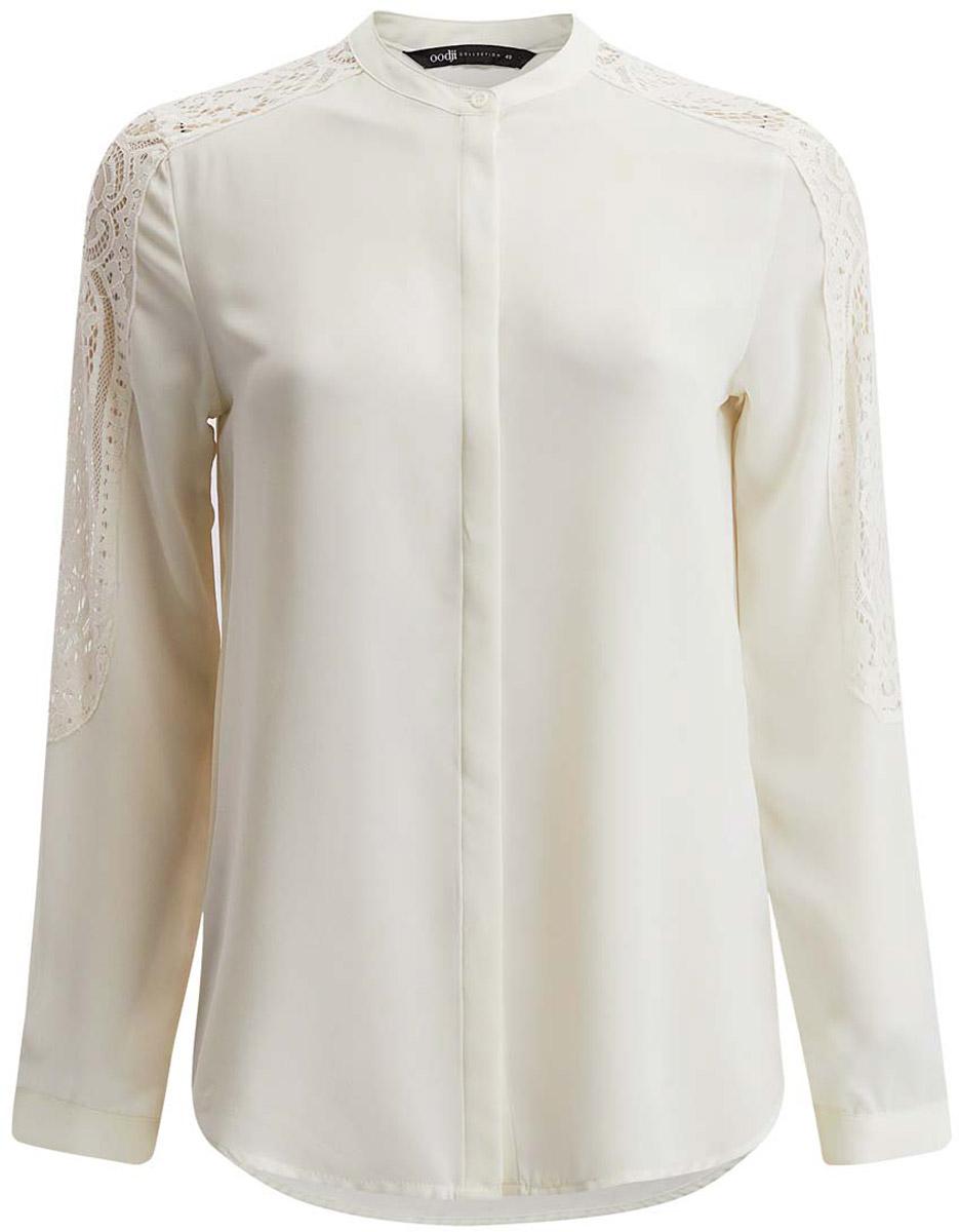 21411087/36215/4500NЖенская блузка oodji Collection выполнена из 100% полиэстера. Модель с круглым вырезом горловины и длинными рукавами по всей длине застегивается на пуговицы. Дополнена модель кружевными вставками на рукаве.
