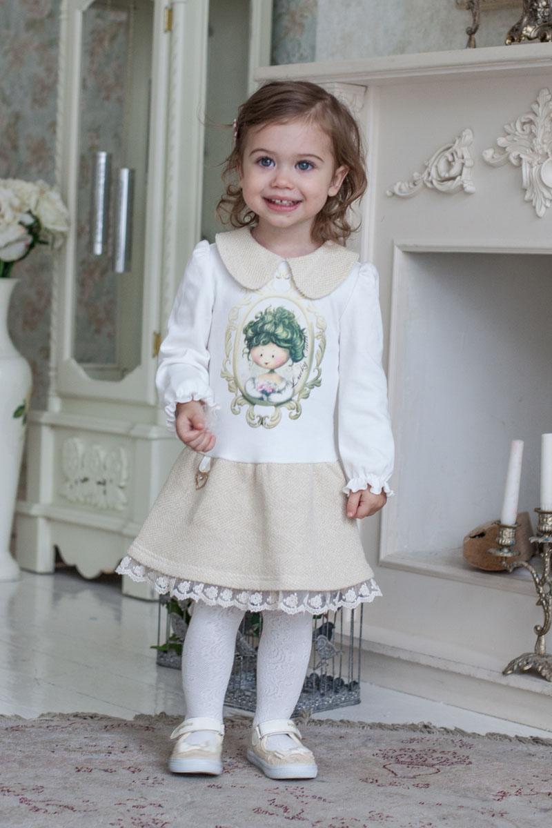 Платье53-63Каждая девочка мечтает стать принцессой. Какая принцесса в своих фантазиях не будет представлять себя в прекрасном наряде? Вот и наши дизайнеры решили, что юные леди должны и в повседневной одежде выглядеть стильно и красиво. Позолоченный футер в сочетании с интерлоком (трикотажная ткань из 100% хлопка) обладает невероятной мягкостью и бережно заботится о детской коже. Небольшое присутствие золотой металлизированной нити (люрекса) добавляет особое благородство наряду. Сердечко, украшающее юбку, придает наряду праздничный блеск, рукава со сборками – элегантность. В платье от Lucky Child юная принцесса каждый день будет в центре внимания.