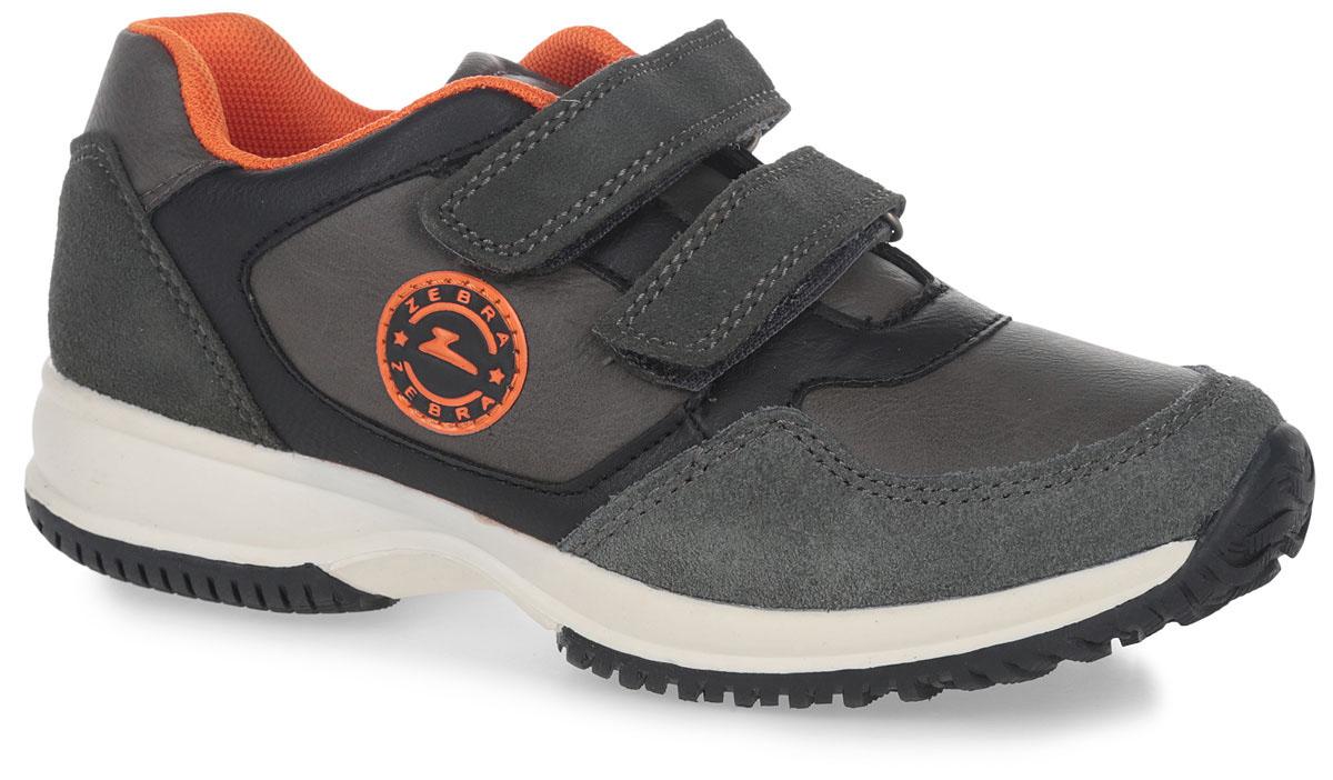 10920-10Кроссовки от фирмы Зебра выполнены из искусственной кожи. Застежки-липучки обеспечивают надежную фиксацию обуви на ноге ребенка. Подкладка выполнена из текстиля, что предотвращает натирание и гарантирует уют. Стелька с поверхностью из натуральной кожи оснащена небольшим супинатором с перфорацией, который обеспечивает правильное положение ноги ребенка при ходьбе и предотвращает плоскостопие. Подошва с рифлением обеспечивает идеальное сцепление с любыми поверхностями.