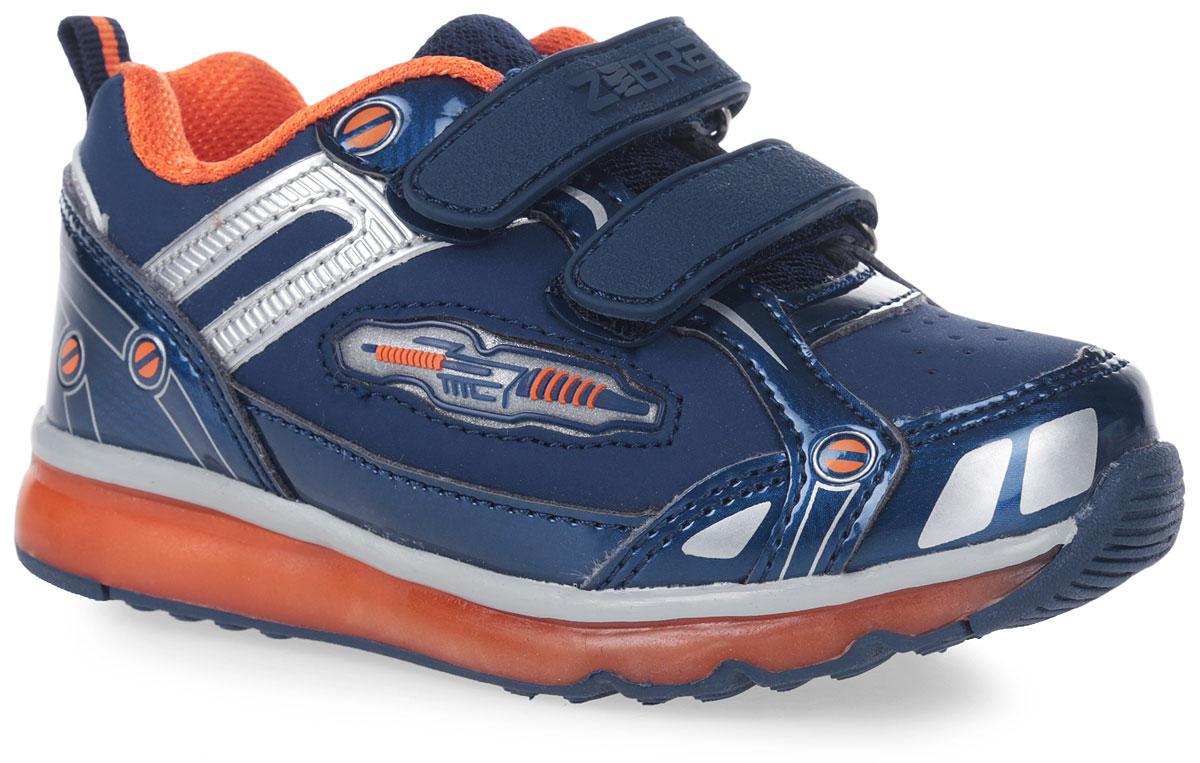 10864-5Кроссовки от фирмы Зебра выполнены из искусственной кожи. Застежки-липучки обеспечивают надежную фиксацию обуви на ноге ребенка. Подкладка выполнена из текстиля, что предотвращает натирание и гарантирует уют. Стелька с поверхностью из натуральной кожи оснащена небольшим супинатором с перфорацией, который обеспечивает правильное положение ноги ребенка при ходьбе и предотвращает плоскостопие. Подошва с рифлением обеспечивает идеальное сцепление с любыми поверхностями.