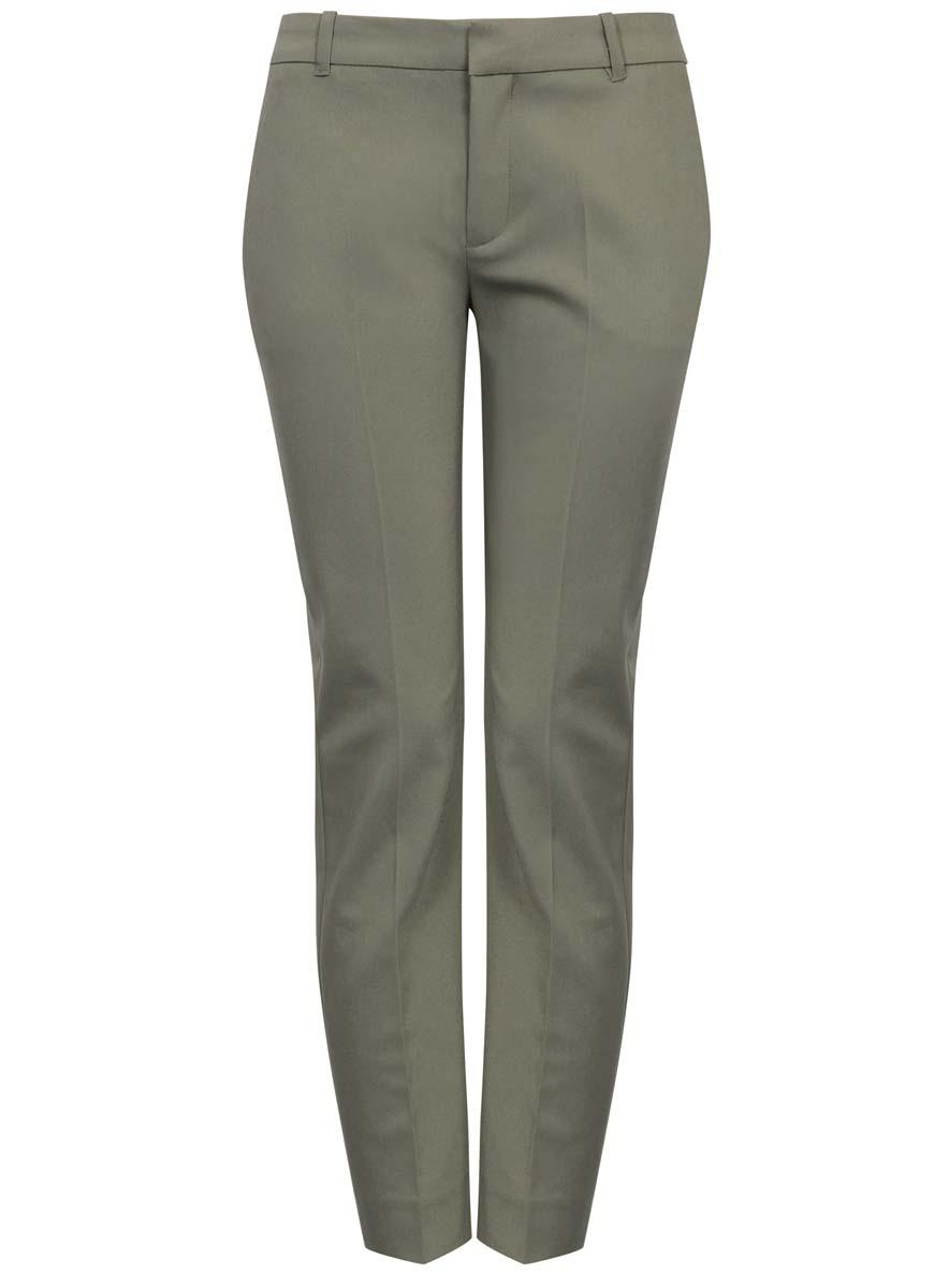Брюки21701091/33574/6600NЖенские классические укороченные брюки oodji Collection выполнены из высококачественного материала. Модель стандартной посадки застегивается на пуговицу в поясе и ширинку на застежке-молнии. Пояс имеет шлевки для ремня. Спереди брюки дополнены втачными карманами, сзади - прорезными.