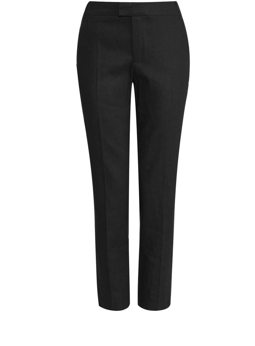 Брюки21701092/16009/3900NСтильные женские брюки oodji Collection изготовлены из натурального льна с добавлением вискозы. Модель прямого кроя застегивается на потайную пуговицу, металлический крючок в поясе и ширинку на застежке-молнии, имеются шлевки для ремня. Брюки со стандартной талией имеют спереди два втачных кармана, а сзади декорированы имитацией прорезных карманов.