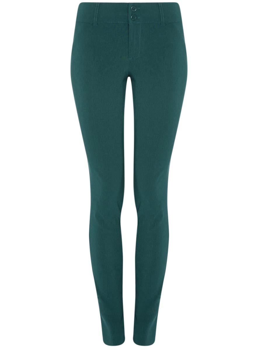 Брюки11700212/14007/2900NСтильные женские брюки oodji Ultra выполнены из качественного комбинированного материала. Модель со средней посадкой застегивается на молнию и две пуговицы в поясе, имеются шлевки для ремня. По бокам и сзади изделие дополнено имитацией прорезных карманов.
