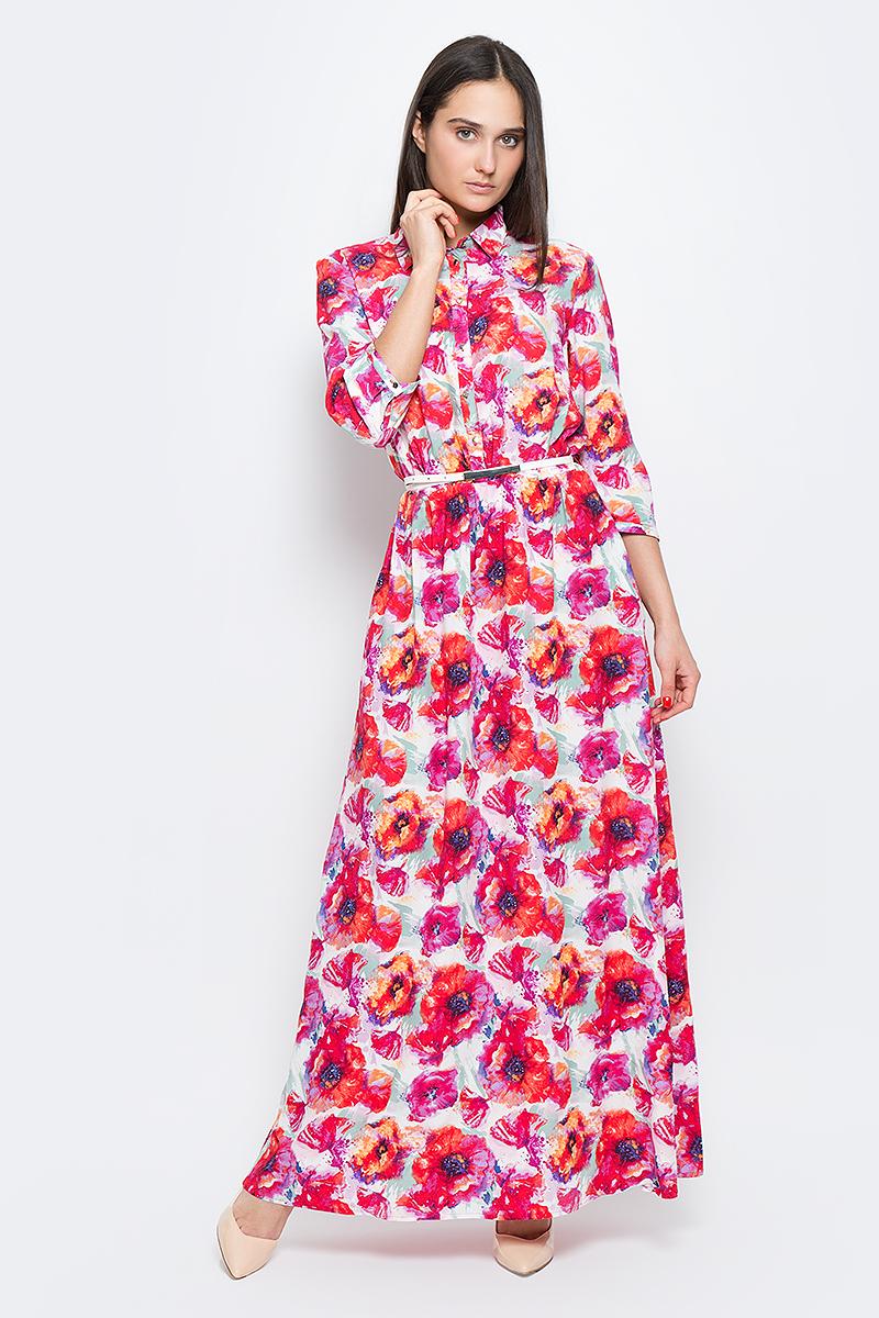B17-11072_139Красивое платье Finn Flare изготовлено из 100% вискозы. Модель с отложным воротником и рукавами 3/4 на талии дополнена эластичной резинкой. Изделие застегивается на пуговицы и дополнено поясом. Оформлена модель цветочным принтом.