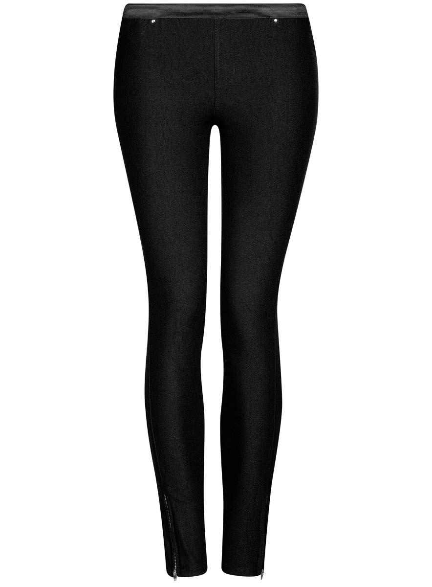 Брюки11713071B/31266/2900NЖенские брюки oodji Ultra выполнены из высококачественного материала. Зауженная модель стандартной посадки. Пояс оформлен эластичной резинкой. Сзади брюки дополнены двумя накладными карманами.