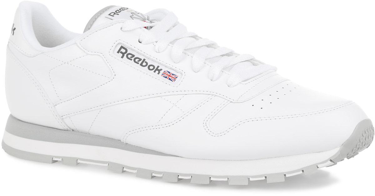 Кроссовки2214Стильные мужские кроссовки от Reebok CLassic Leather отличаются легкостью и оригинальным дизайном. Изделие выполнено из натуральной кожи и оформлено по верху прострочкой, фактурными швами и легкой перфорацией на мысе. Язычок - из текстиля. Низкий дизайн предназначен для полной свободы движений. Подкладка и стелька, исполненные из текстиля, способствуют поддержанию оптимального микроклимата, сохраняя ощущение комфорта и сухости. Верх кроссовок оформлен шнуровкой, которая гарантирует надежную фиксацию изделия. На заднике обувь декорирована принтом в виде логотипа бренда. Сбоку модель дополнена вставкой из текстиля, а язычок - нашивкой с логотипом бренда. Формованная промежуточная подошва ЭВА обеспечивает амортизацию без утяжеления. Подошва с рельефным протектором обеспечивает сцепление с любой поверхностью. Оригинальные кроссовки придутся вам по душе.
