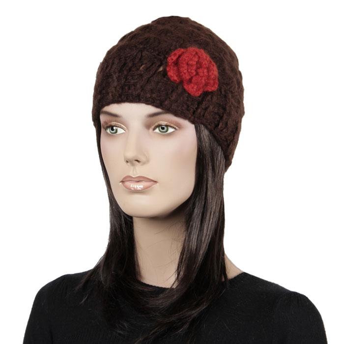 96Ш1А_106Женская шапка выполнена из шерсти и акрила. Модель выполнена узорной вязкой и декорирована вязаным цветком. Инструкция по уходу: стирать при температуре не выше 30°C, не отбеливать, не отжимать на центрифуге, гладить при низкой температуре.