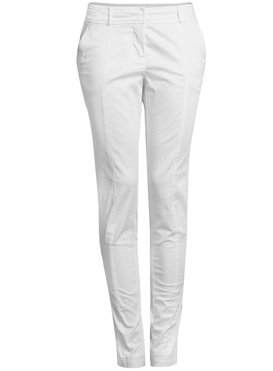 Брюки11707081/14522/1000NЖенские брюки oodji Ultra выполнены из высококачественного материала. Модель стандартной посадки застегивается на пуговицу в поясе и ширинку на застежке-молнии. Пояс имеет шлевки для ремня. Спереди брюки дополнены втачными карманами, сзади - прорезными.