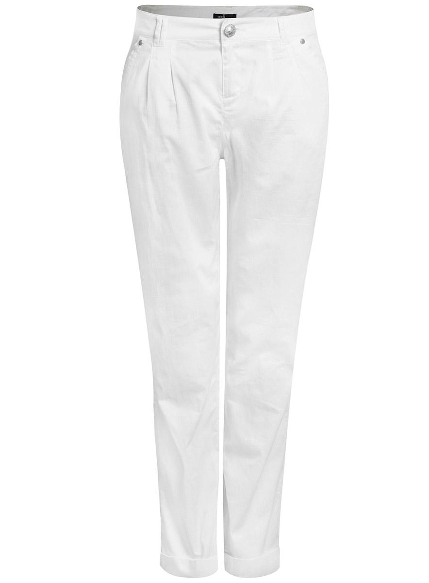 Брюки11709023/14121/1000NЖенские брюки oodji Ultra выполнены из высококачественного материала. Модель стандартной посадки застегивается на пуговицу в поясе и ширинку на застежке-молнии. Пояс имеет шлевки для ремня. Спереди брюки дополнены втачными карманами, сзади - прорезными на пуговицах.