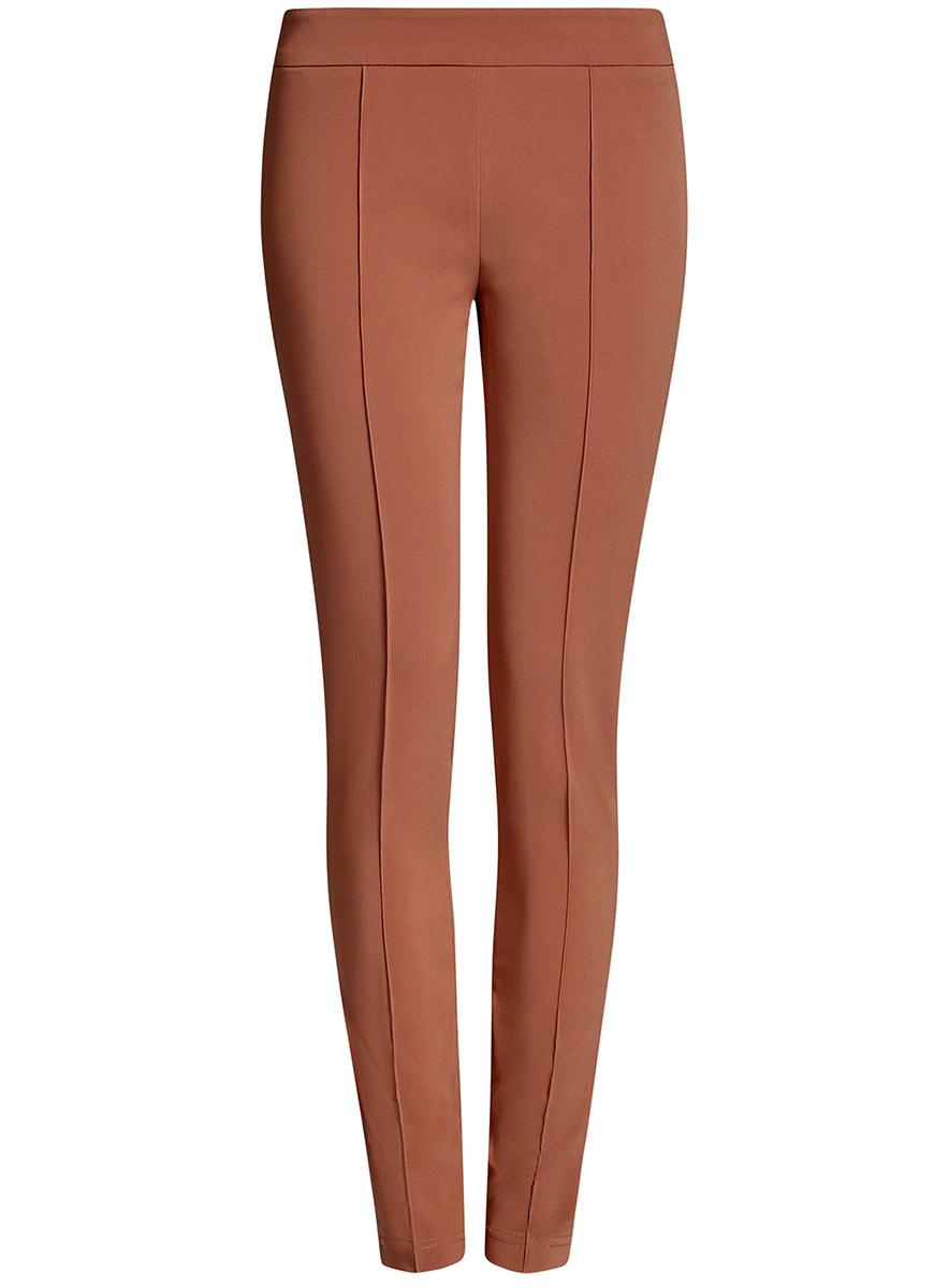 Брюки11707099-1B/42250/2300NЖенские брюки oodji Ultra выполнены из высококачественного материала. Зауженная модель стандартной посадки застегивается сбоку на застежку-молнию.