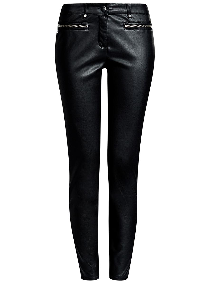 Брюки18G07088/45059/2900NЖенские брюки oodji Ultra выполнены из искусственной кожи. Модель-слим стандартной посадки застегивается на пуговицу в поясе и ширинку на застежке-молнии