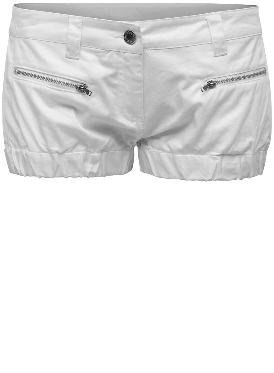 Шорты11801051/18104/1000NЖенские шорты oodji Ultra выполнены из эластичного хлопка. Модель застегивается на молнию и пуговицу в поясе, также имеются шлевки для ремня. Спереди модель дополнена двумя карманами на молнии. Низ шортов стянут резинками.