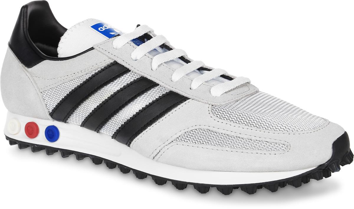 BB1206Мужские кроссовки adidas Originals La Trainer Og выполнены из натуральной кожи разной текстуры и текстиля. Модель оформлена фирменными нашивками. Шнурки надежно зафиксируют модель на ноге. Кроссовки оснащены системой с регулировкой амортизации задней части стопы. Внутренняя поверхность из сетчатого текстиля комфортна при движении. Стелька выполнена из легкого ЭВА-материала с поверхностью из текстиля. Подошва изготовлена из высококачественной резины и дополнена протектором.