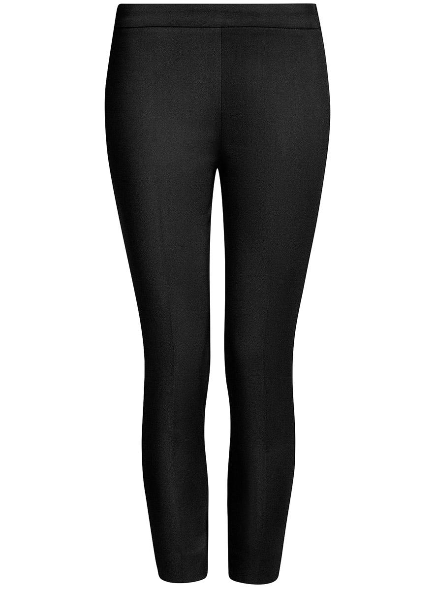 Брюки11703095/33574/2900NЖенские укороченные брюки oodji Ultra выполнены из высококачественного материала. Зауженная модель стандартной посадки застегивается сбоку на застежку-молнию.