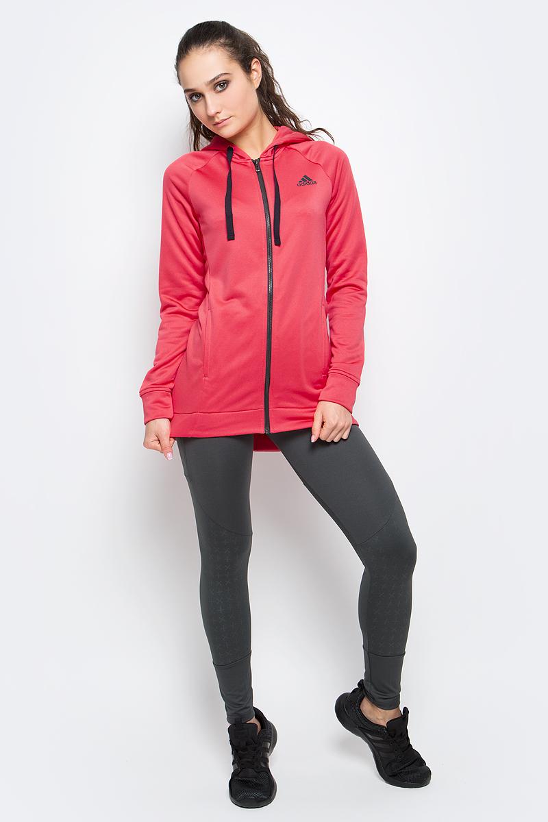 Спортивный костюмBK4675Женский спортивный костюм adidas Hoody&Tight Ts включает в себя легкую толстовку и леггинсы. Толстовка с длинными рукавами-реглан и капюшоном застегивается на застежку-молнию спереди. Модель изготовлена из высококачественного полиэстера. Модель дополнена двумя втачными карманами спереди. Объем капюшона регулируется при помощи шнурка-кулиски. Леггинсы прямого кроя и средней посадки имеют широкую эластичную резинку на поясе. Комфортные эластичные швы не стесняют движений и исключают натирание даже во время интенсивных тренировок.