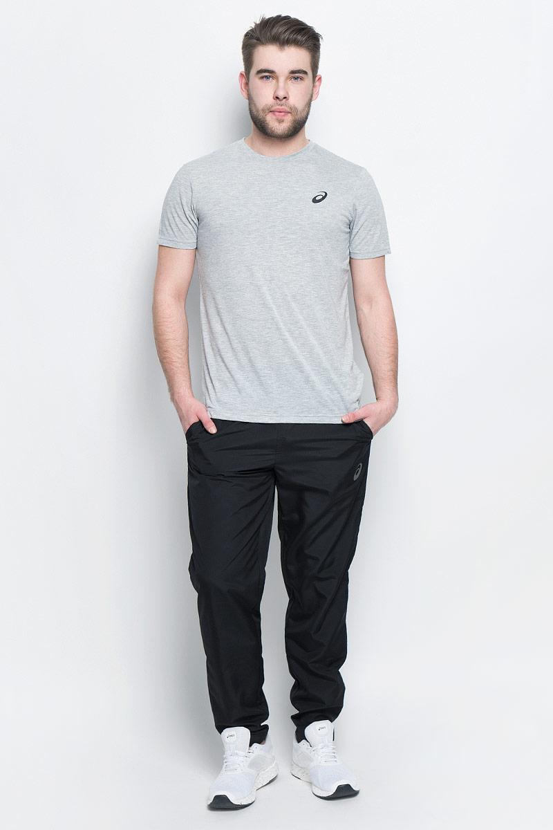 Брюки спортивные134101-0904Спортивные мужские брюки Asics Woven Pant выполнены из плотного полиэстера. Модель имеет широкую резинку на поясе, объем талии регулируется при помощи шнурка-кулиски. Брюки дополнены двумя открытыми втачными карманами спереди. Снизу брючин расположены застежки-молнии. Модель украшена светоотражающими полосками.