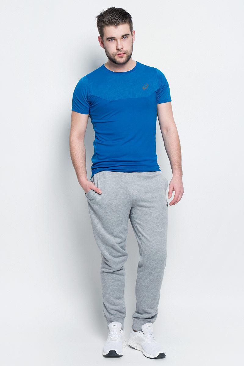 134795-0714Спортивные мужские брюки Asics Essentials Pant выполнены из полиэстера с добавлением вискозы. Комфортные плоские швы предотвращаются натирание. Модель имеет широкую резинку на поясе, объем талии регулируется при помощи шнурка-кулиски. Брюки дополнены двумя открытыми втачными карманами спереди и накладны карманом сзади. Брючины дополнены эластичными манжетами по низу