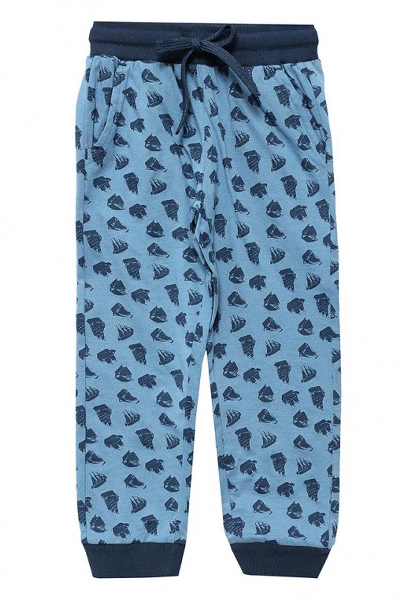 Брюки для домаPH-7865/003-7100Удобные домашние брюки для мальчика Sela выполнены в спортивном стиле из натурального хлопка и оформлены оригинальным принтом. Брюки прямого кроя и стандартной посадки на талии имеют широкий пояс на мягкой резинке, дополнительно регулируемый шнурком. Низ брючин дополнен мягкими трикотажными резинками.