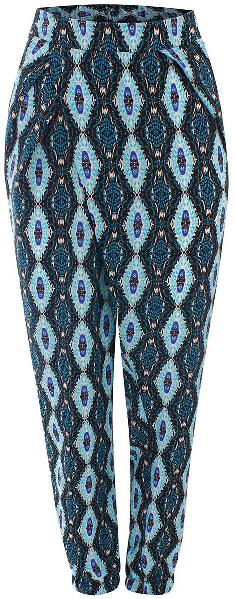 Брюки11700196/19777/2973EЛегкие женские брюки oodji выполнены из 100% полиэстера. Модель свободного кроя со средней посадкой, низ брючин заужен и дополнен резинками. Спереди изделие дополнено втачными карманами.