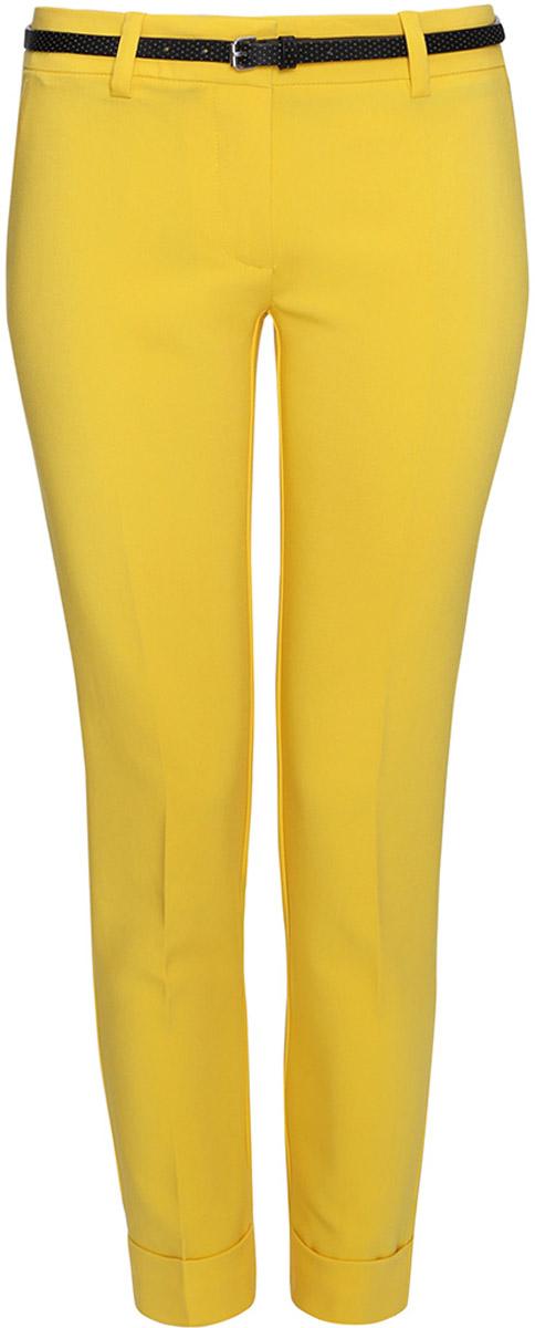 Брюки11703057-5/38/5200NЖенские брюки oodji Ultra выполнены из высококачественного материала. Модель стандартной посадки застегивается на пуговицу в поясе и ширинку на застежке-молнии. Пояс имеет шлевки для ремня. Спереди брюки дополнены втачными карманами, сзади - прорезными.