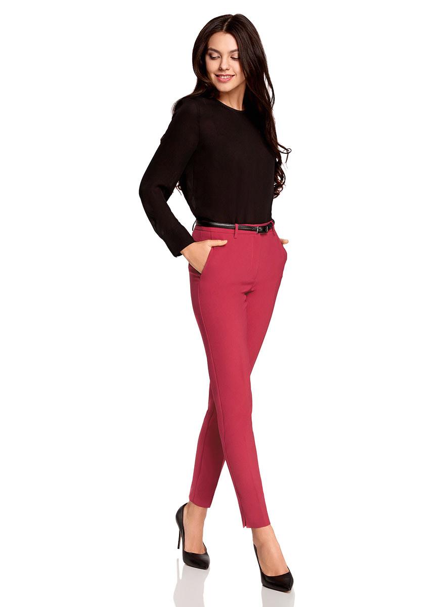 Брюки11706197/42830/2900NСтильные женские брюки oodji Ultra выполнены из полиэстера с добавлением эластана. Модель с стандартной посадкой оформлена сзади декоративными карманами. Застегиваются брюки на молнию, пуговицу и застежку-крючок. По бокам изделие дополнено втачными карманами.Также модель оснащена шлевками и тонким ремнем.