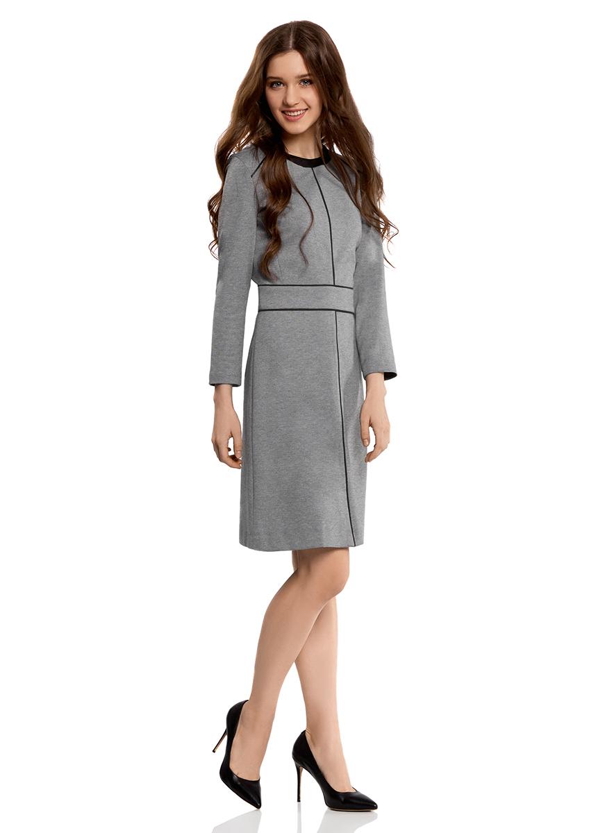 Платье24011012/35477/2500MПриталенное платье oodji Collection выполнено из мягкого трикотажа с контрастной отделкой. Модель средней длины с круглым вырезом горловины и рукавами 7/8 застегивается на спинке на скрытую застежку-молнию.