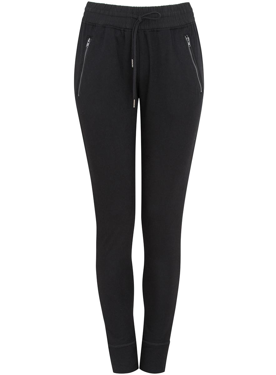 Брюки спортивные16700046/42335/2329BСпортивные женские брюки oodji Ultra выполнены из полиэстера и вискозы. Модель имеет широкую резинку на поясе, объем талии регулируется при помощи шнурка-кулиски. Спереди брюки дополнены двумя прорезными карманами на застежках-молниях.