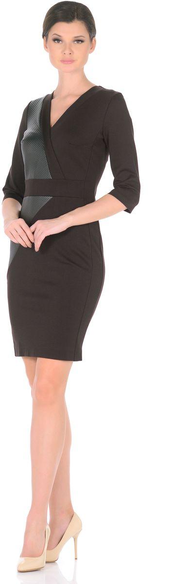 Платье3189-А46-1Сделать офисный образ более женственным легко - поменяйте строгий брючный костюм на элегантное платье от Rosa Blanco. Эффектные вставки из искусственной кожи придают элегантной классической модели дерзкий современный вид. Крой с вытачками выделяет талию и привлекательные изгибы силуэта, благодаря чему модель искусно облегает фигуру, виртуозно демонстрируя изящные женские линии. Глубокий V-образный вырез спереди подчеркивает роскошное декольте, а эффект запаха на вырезе еще больше привлекает к ней внимание. Рукава ? соответствуют актуальным трендам, а разрез сзади обеспечивает свободу движений. На спинке длинная застежка-молния. Плотный и приятный для тела материал стрейч с высоким содержанием вискозы прекрасно сидит по фигуре. Длина изделия 99,5-101 см. Состав ткани: 71% вискоза 24% полиэстер 5% эластан. Рост модели на фото 170 см (+ каблук).