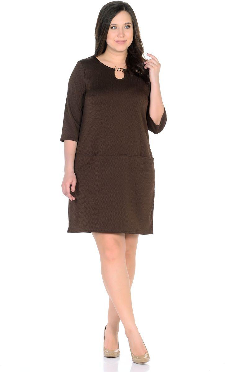 Платье33191-9Однотонное платье прямого силуэта с горизонтальными кармашками на линии бедер из фактурной ткани. Горловину, в виде капельки, украшает золотая пряжка со стразами. Рукав 3/4. Длина изделия 95-104 см. Ткань - плотный трикотаж, характеризующийся эластичностью, растяжимостью и мягкостью. Состав ткани: 72% вискоза 25%полиэфир 3%лайкра. Рост модели на фото 170 см (+ каблук).