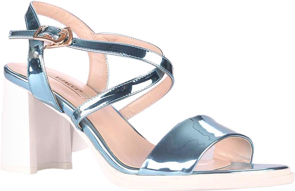 Босоножки39524Стильные босоножки Vitacci прекрасно подчеркнут ваш стиль. Модель изготовлена из качественной искусственной кожи. Изящный ремешок с металлической пряжкой надежно фиксирует модель на ноге. Подошва выполнена с высоким устойчивым каблуком.